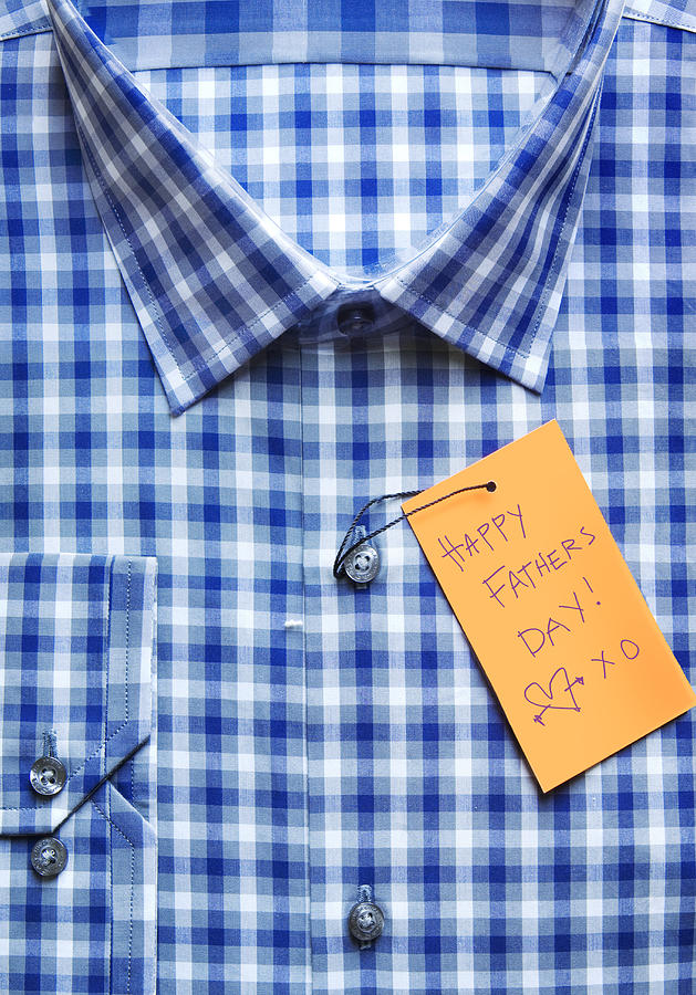 Close-up Of Shirt With Happy Fathers Day Tag Photograph