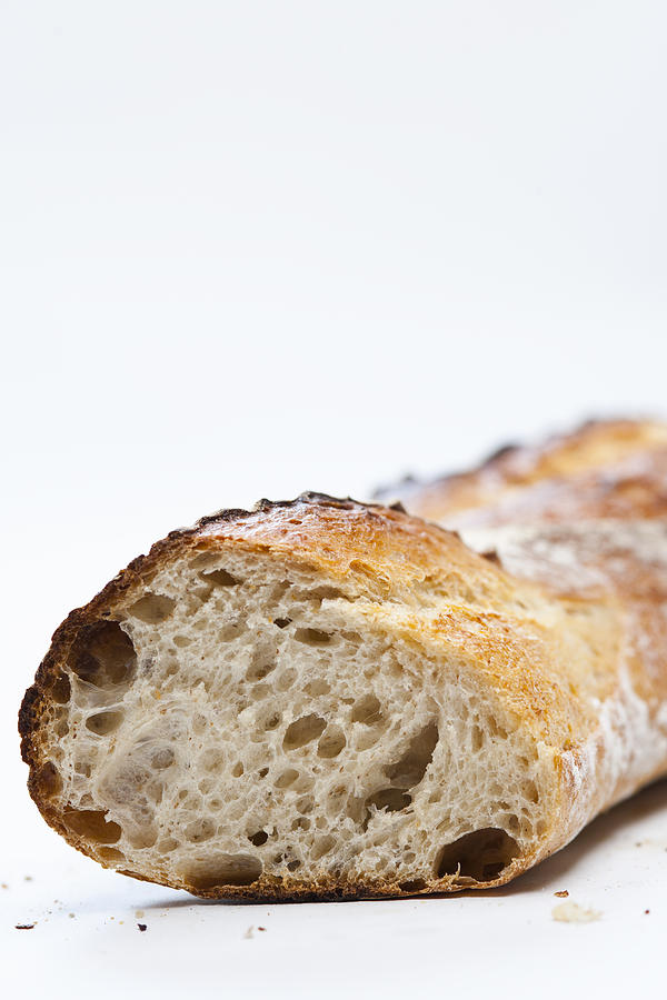 Vertical Photograph - Close Up Of Sliced Loaf Of Bread by Henn Photography