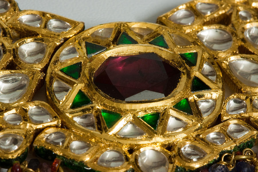 Jewel Photograph - Close Up Of The Middle Pendant Section Of A Green And White Stone Inlaid Necklace by Ashish Agarwal