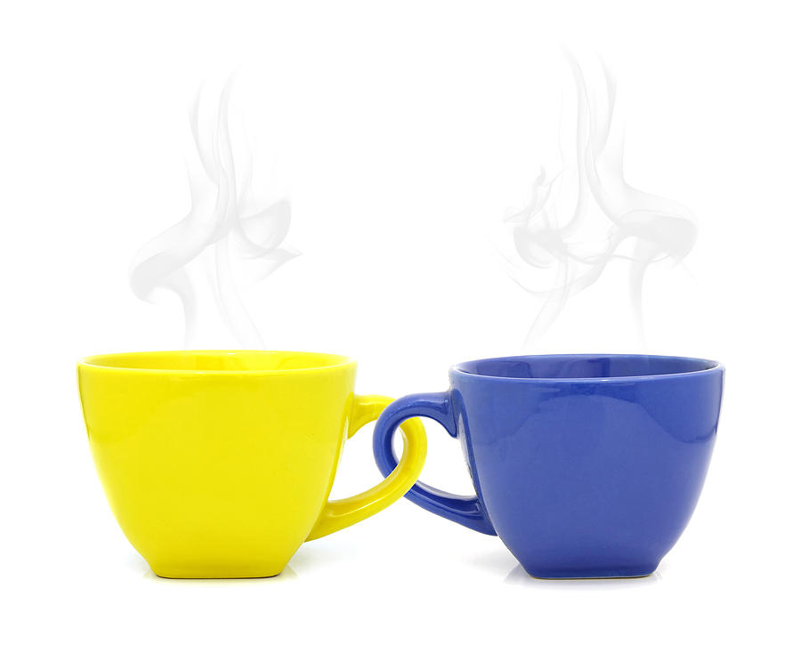Color Cup With Hot Drink On White Background Photograph