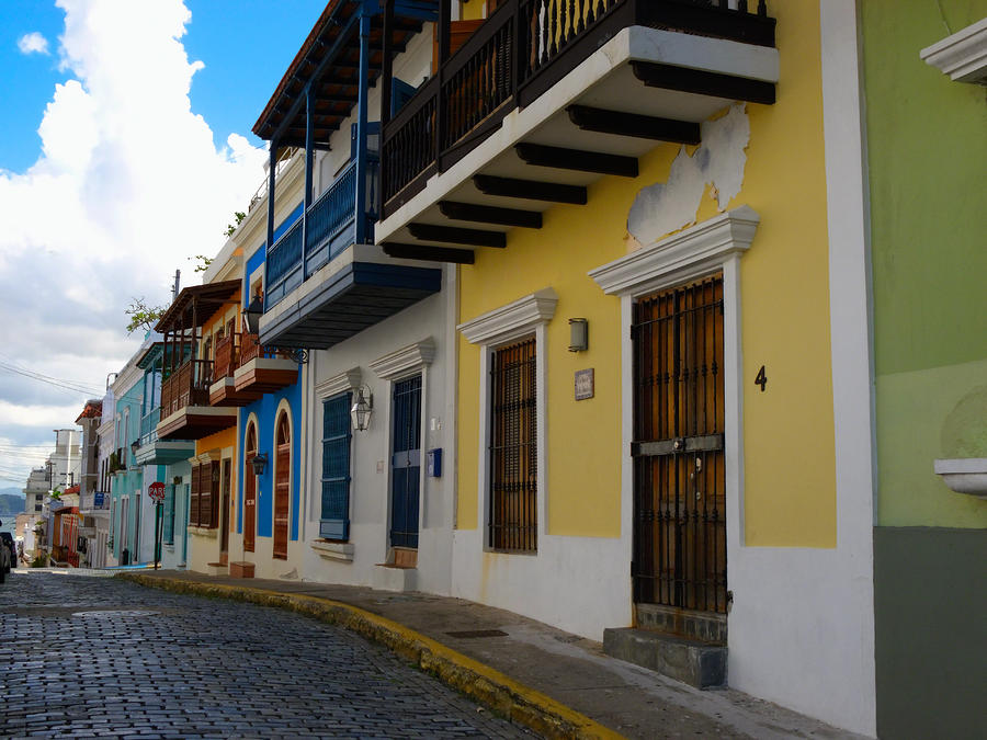 Colorful Houses Along A Cobblestone Street Photograph