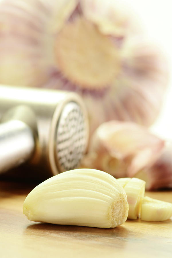 Antioxidant Photograph - Composition With Fresh Garlic On Breadboard by T Monticello