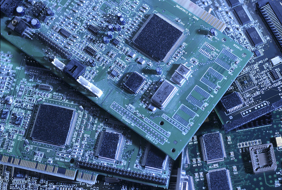 Computer Boards And Chips Lie In A Pile Photograph