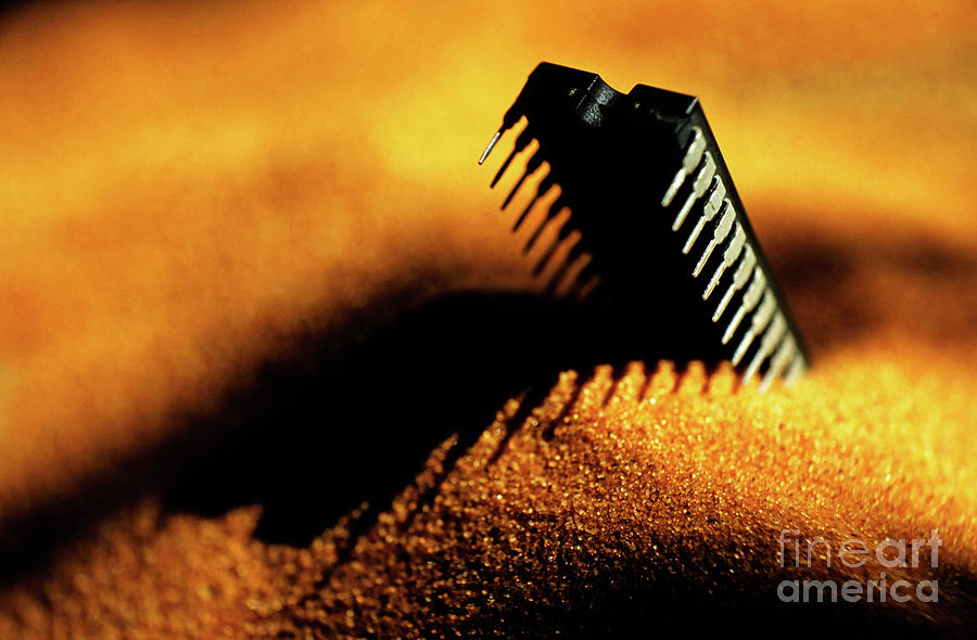 Computer Chip Half-buried In Sand Photograph