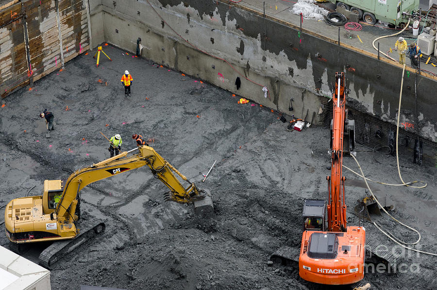 Construction Site Diggers And Workmen In The Foundation Pit Of A New Building Seattle Photograph
