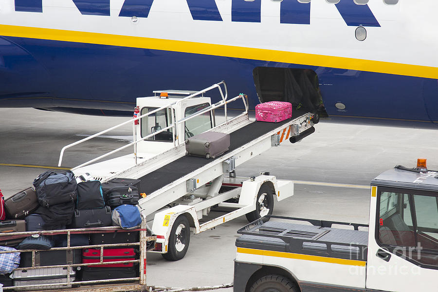 Conveyor Unloading Luggage Photograph  - Conveyor Unloading Luggage Fine Art Print