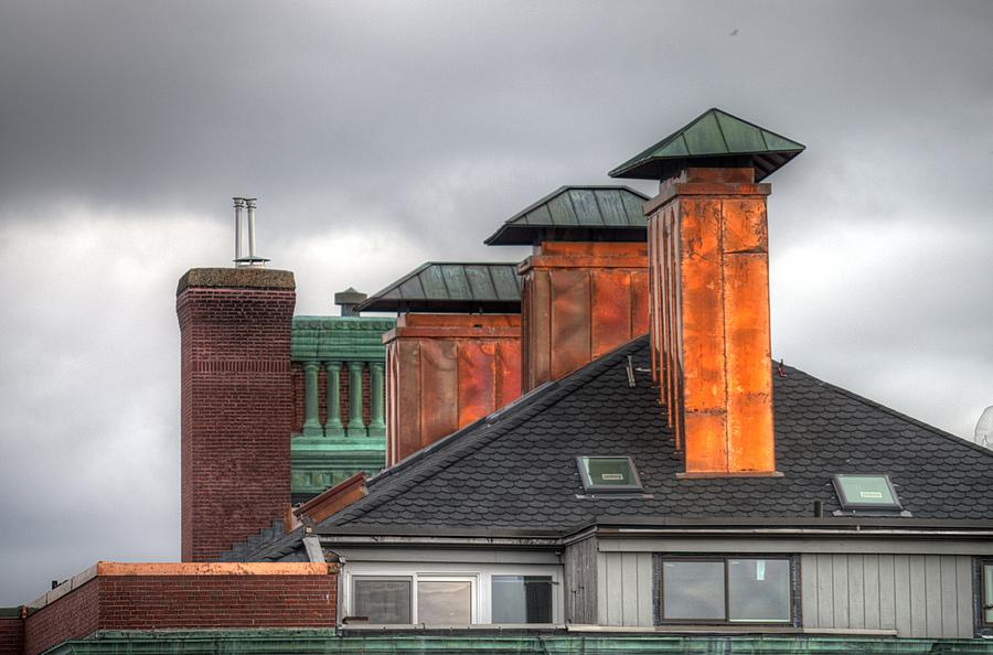 Copper-lined Chimneys On A Grey Sky Photograph