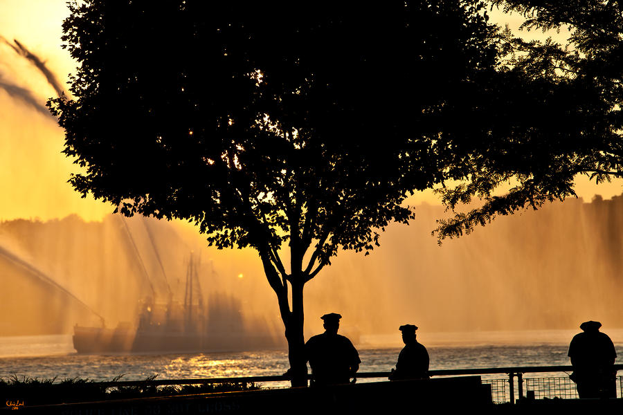 Cops Watch A Fireboat On The Hudson River Photograph