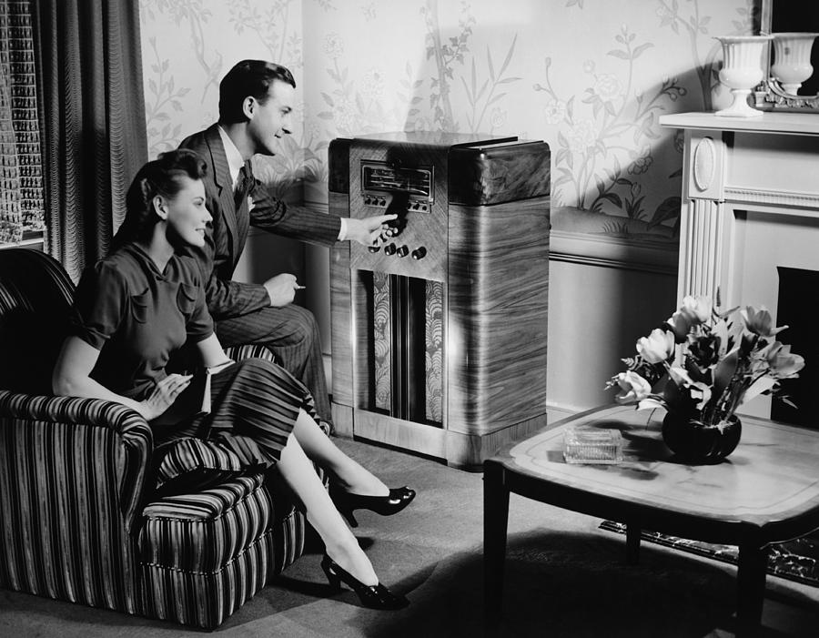 Couple Listening To Radio In Living Room, (b&w) Photograph