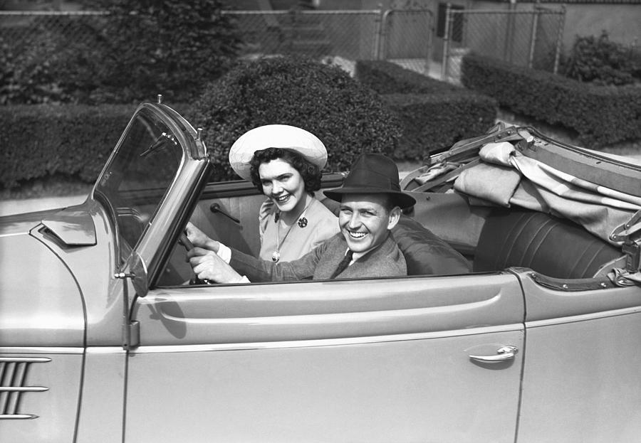 Couple Riding In Old Fashion Convertible Car, (b&w),, Portrait Photograph  - Couple Riding In Old Fashion Convertible Car, (b&w),, Portrait Fine Art Print