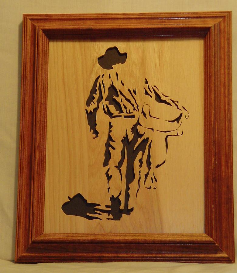 Cowboy And Saddle Sculpture