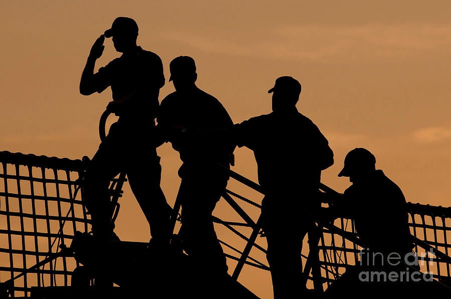 Crewmen Salute The American Flag Photograph