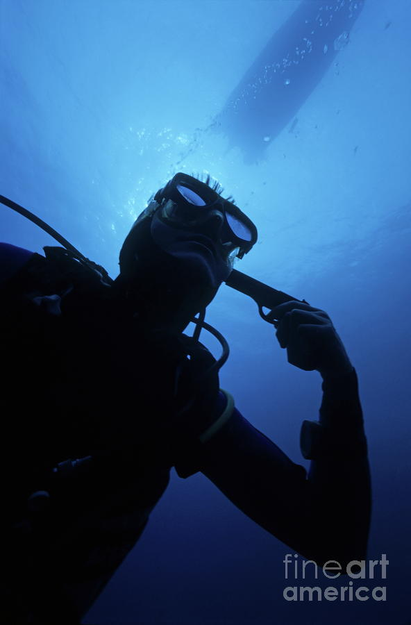 Diver Holding Gun To Head Underwater Photograph