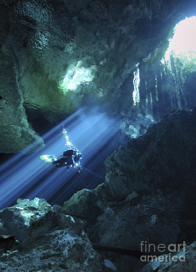 Diver Silhouetted In Sunrays Of Cenote Photograph