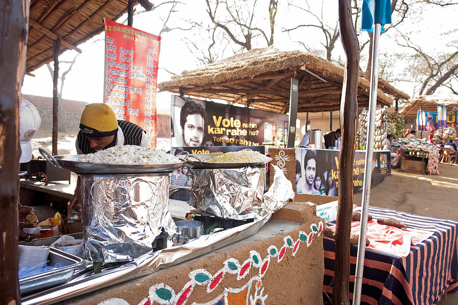 Doing Vendor Duty At Food Stalls In The Surajkand Mela Photograph