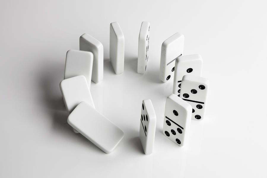 Horizontal Photograph - Dominoes In A Circle Beginning To Fall Over In A Chain Reaction by Larry Washburn