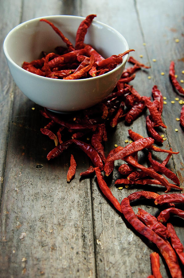 Dried Chilies In White Bowl Photograph