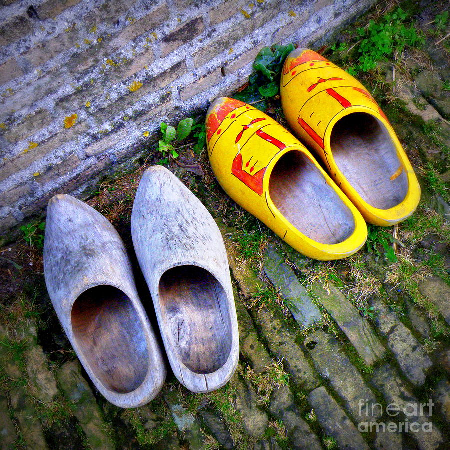 A Pair Of Dutch Wooden Shoes In The Autumn Leaves Royalty Free