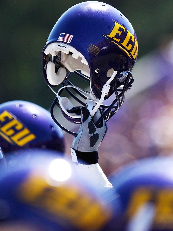 Ecu Helmet Held High Photograph