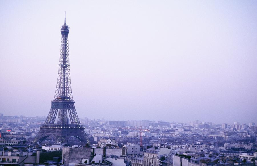 Eiffel Tower At Dusk With Paris Skyline is a photograph by Axiom ...