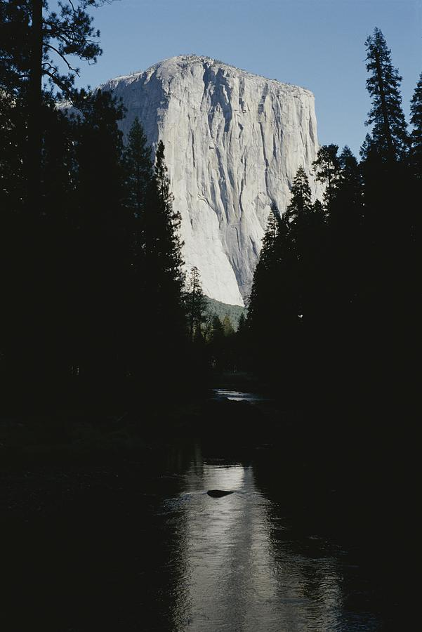 El Capitan Soars Above The Merced River Photograph