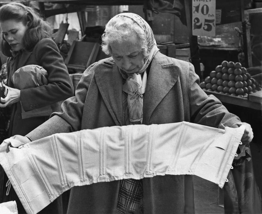 Elderly Woman Evaluating A Corset Photograph