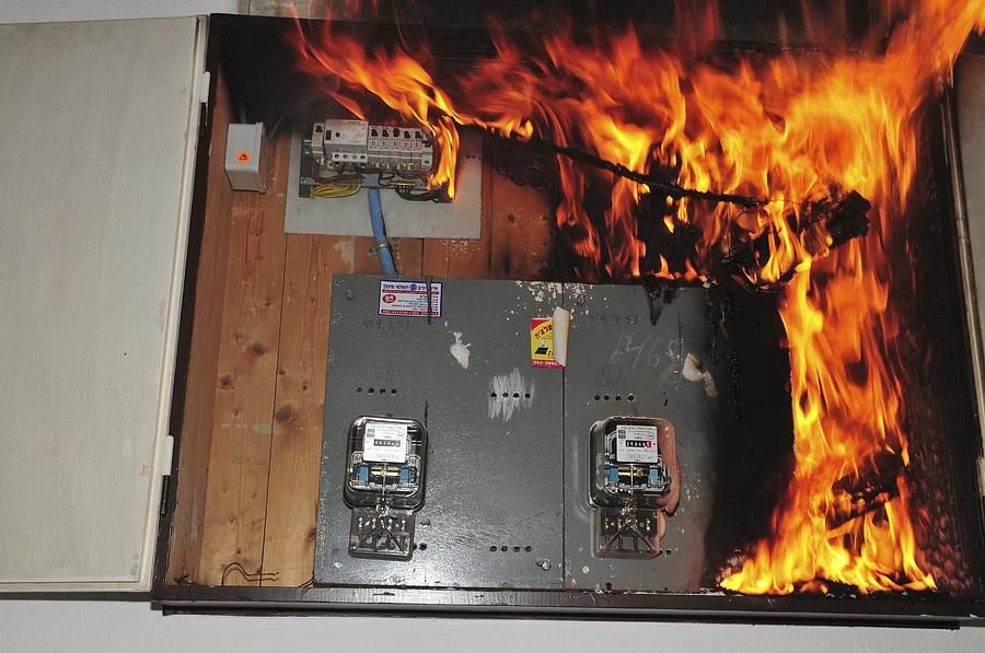 electrical fire in a household fuse box photograph by