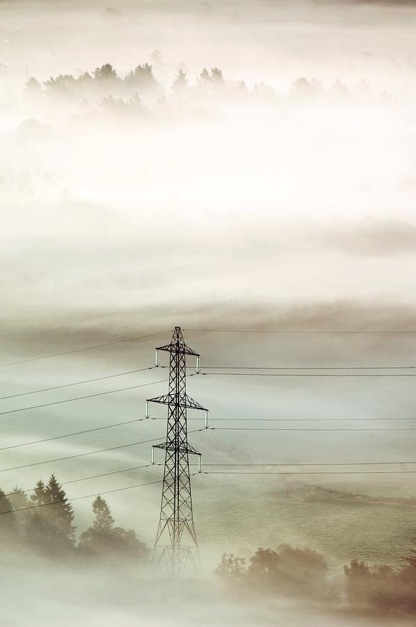 Electricity Pylon In Fog Photograph