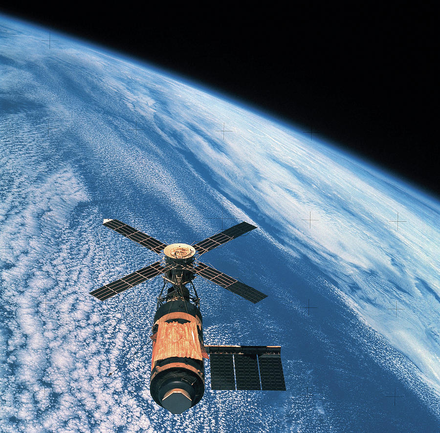 Elevated View Of A Satellite Orbiting In Space Photograph