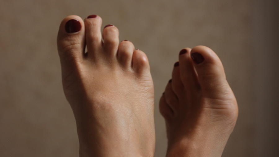 Feet Of A Happy Woman After Coupling Photograph