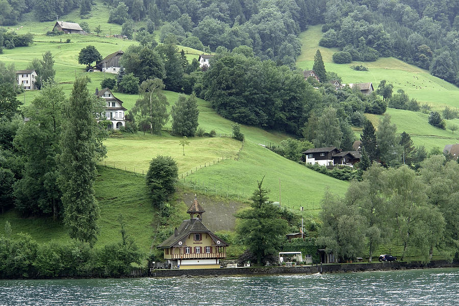 Few Houses On The Slope Of Mountain Next To Lake Lucerne Photograph