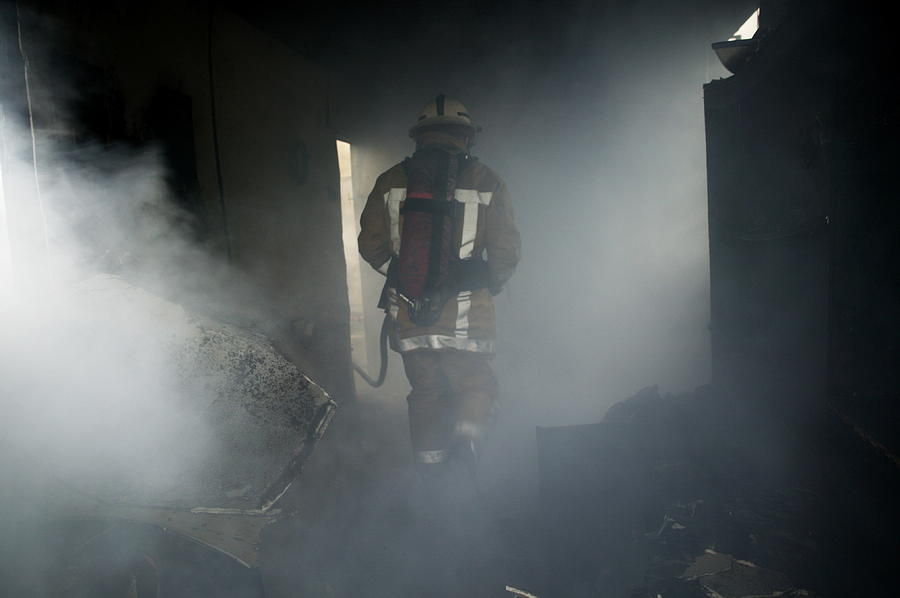 Emergency Service Photograph - Fire Fighter In A Burnt House by Michael Donne