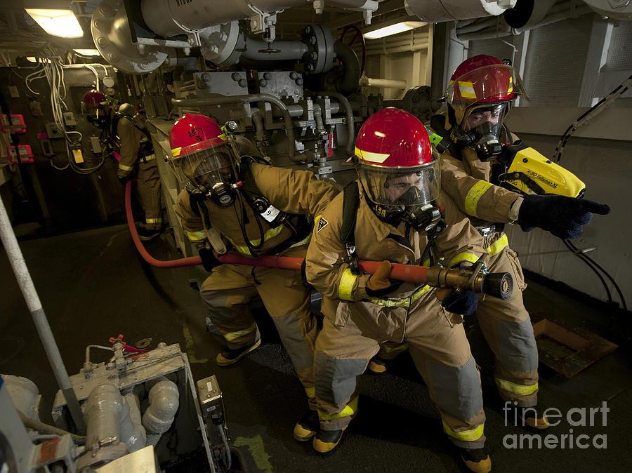 Firemen Combat A Simulated Fire Aboard Photograph