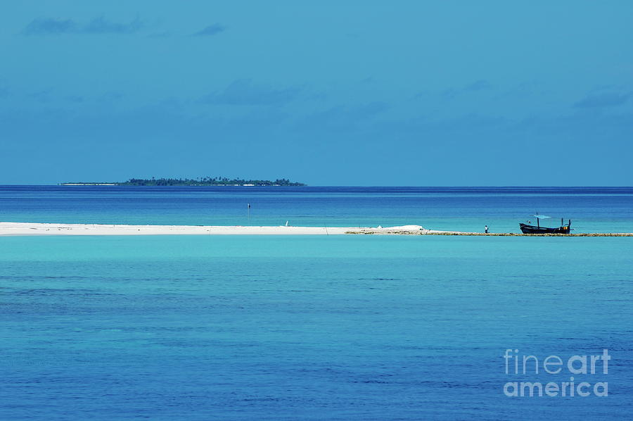 Fishing Boat Anchored On A White Sand Beach With A Tropical Island In The Background In Maldives Photograph  - Fishing Boat Anchored On A White Sand Beach With A Tropical Island In The Background In Maldives Fine Art Print