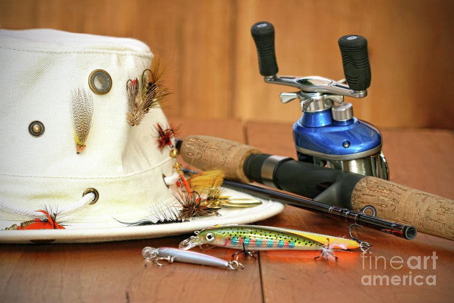 Fishing Reel With Hat And Color Lures Photograph