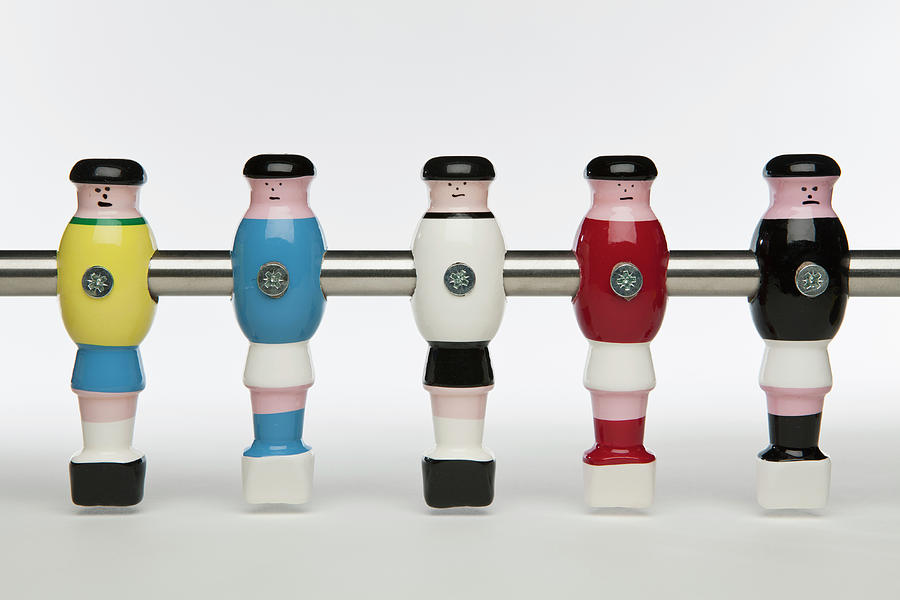 Five Foosball Figurines Wearing Different Uniforms Photograph