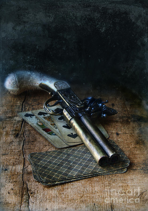 Flint Lock Pistol And Playing Cards Photograph