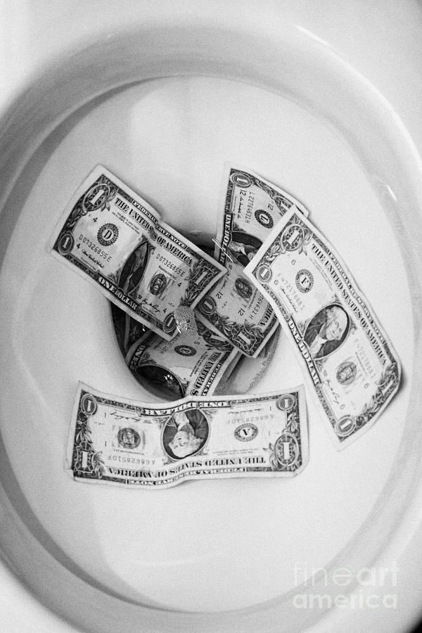 Flushing Us Dollar Bills Down The Toilet Photograph