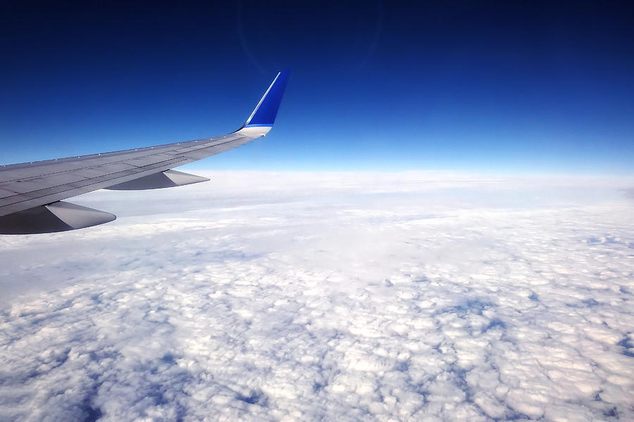 Flying above the clouds is a photograph by tracie kaska which was