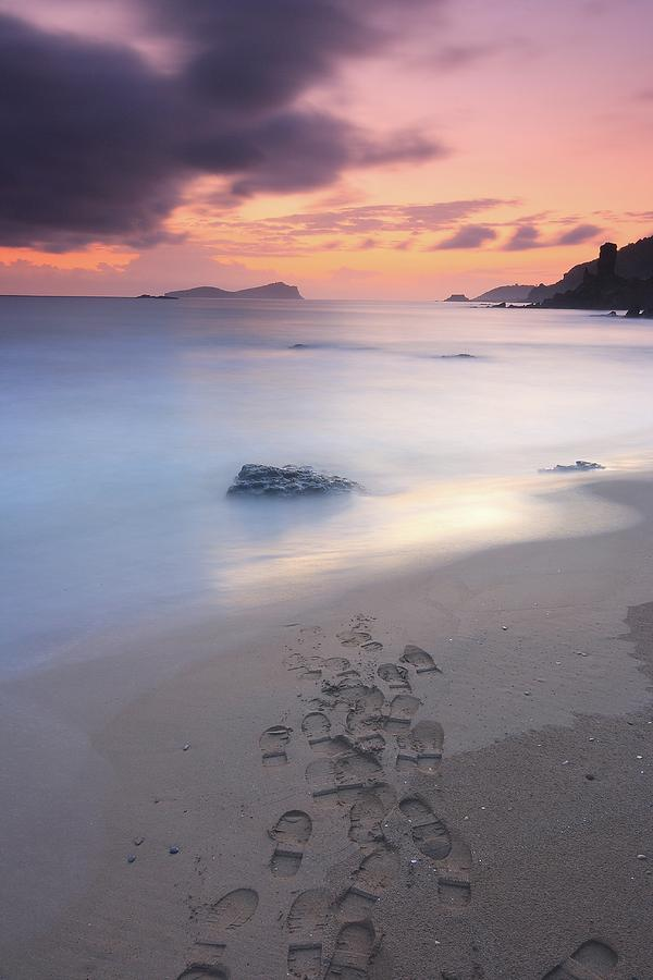 Footprints On Beach At Sunset Photograph