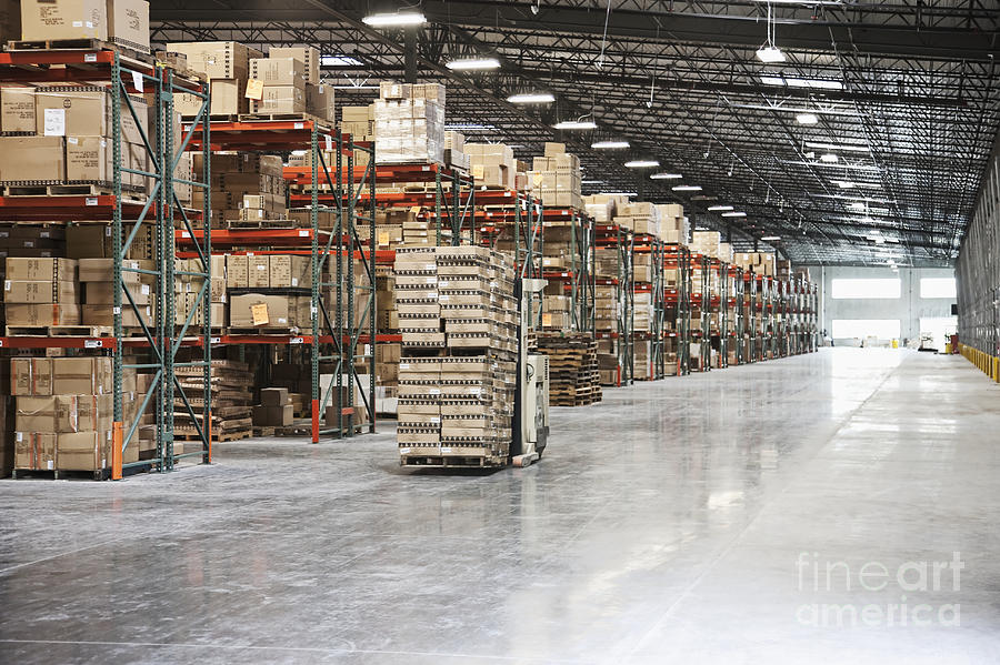 Forklift Moving Product In A Warehouse Photograph