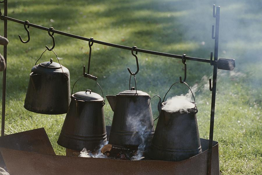 What day is it? Four-metal-coffee-pots-steaming-over-an-michael-s-lewis