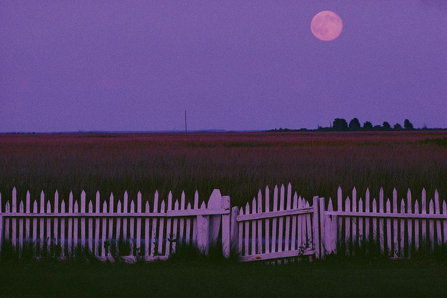 Full Moon Rising Over A Picket Fence Photograph