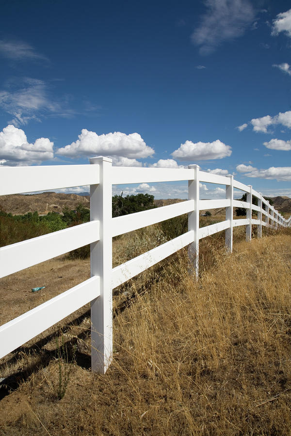 Clouds Photograph - Galloping Fence by Peter Tellone