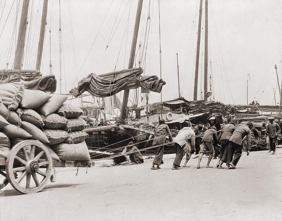 Gang Of Five Chinese Dock Workers Lean Photograph