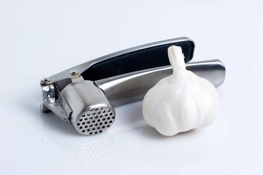 Garlic Press With Garlic Photograph