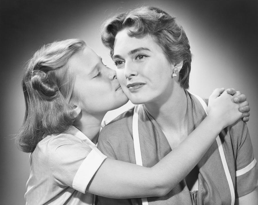 8-9 Years Photograph - Girl (8-9) Kissing Mother, (b&w) by George Marks