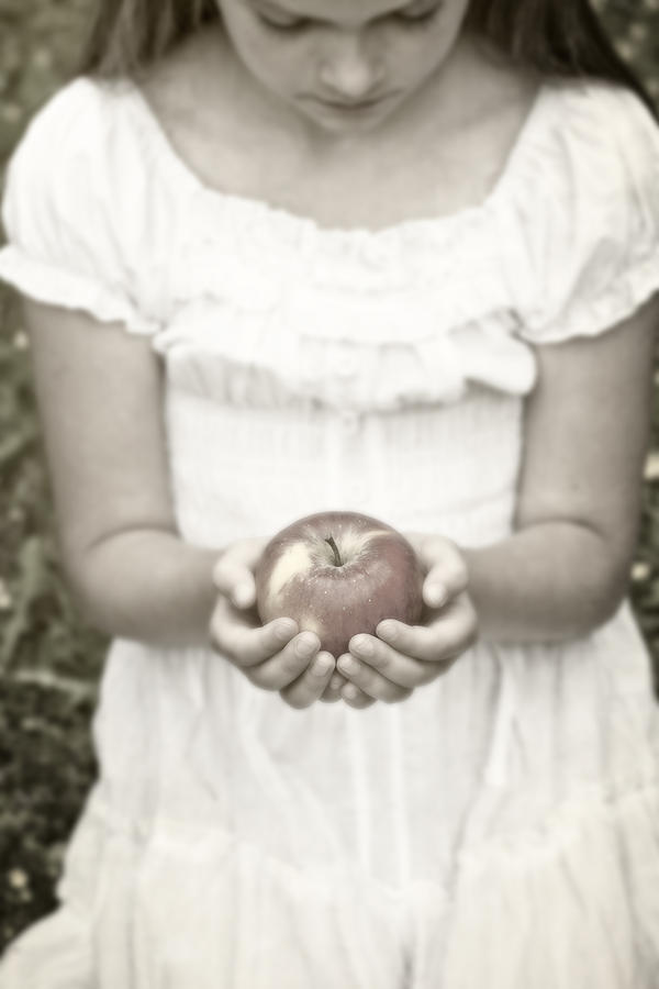 Girl And Apple Photograph