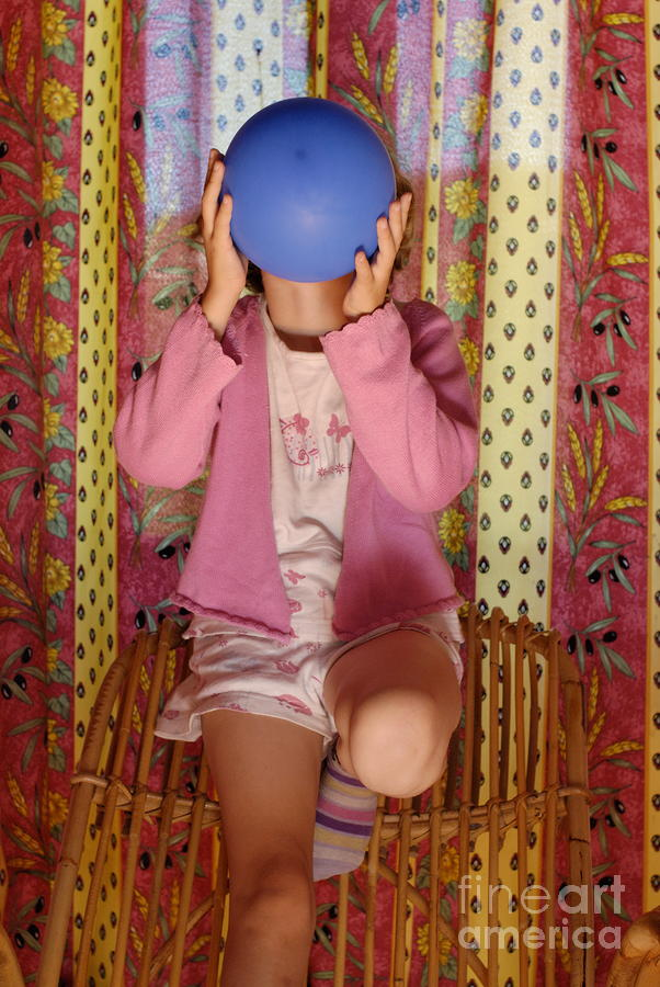 Girl Blowing Up Balloon Photograph