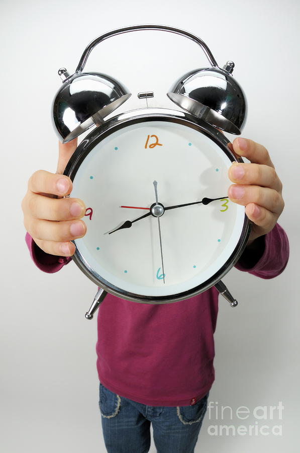 Girl Holding Alarm Clock Over Face Photograph  - Girl Holding Alarm Clock Over Face Fine Art Print